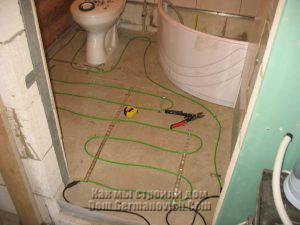 Раскладка и закрепление кабеля теплого пола
